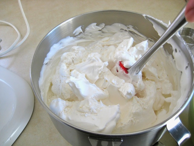 Folding dry ingredients into egg white mixture