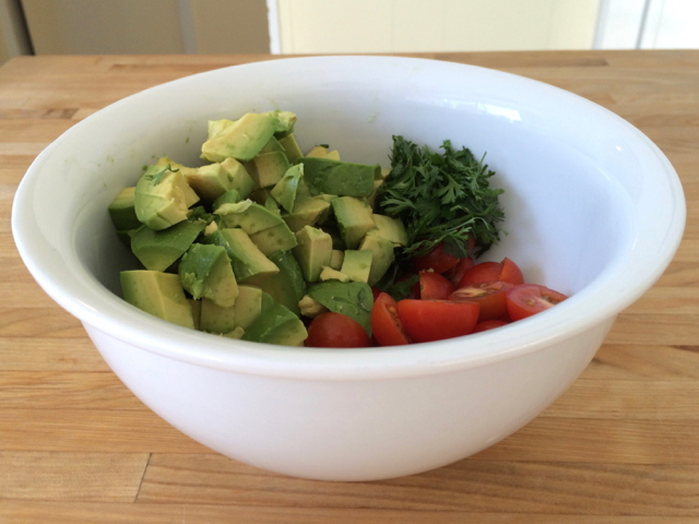 Avocados, cherry tomatoes, and cilantro in bowl