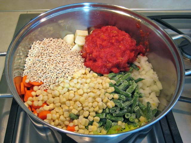 Vegetables and barley added to Dutch oven
