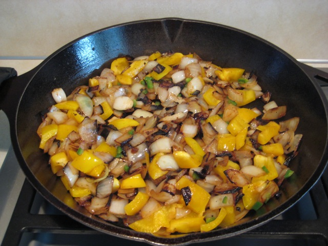 Onions with yellow peppers and jalapeño added