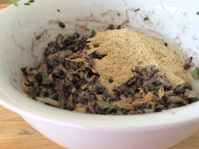 Masa harina and spices added to black bean mixture