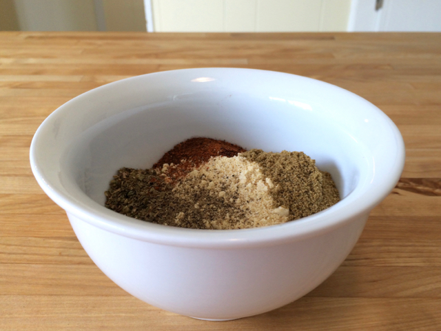 Masa harina and spices in small bowl