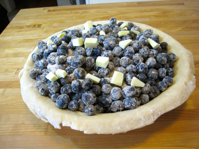 Lemon added; blueberries dotted with butter