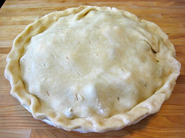 Slits made in top crust to allow air to escape during baking