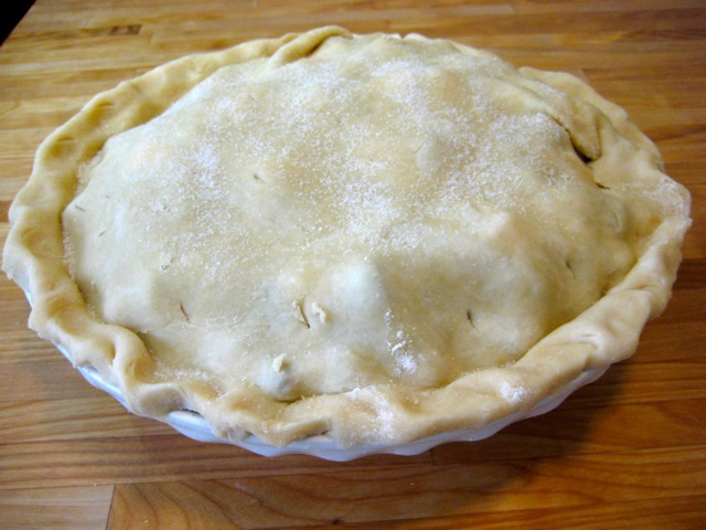 Top crust sprinkled with sugar; ready for oven