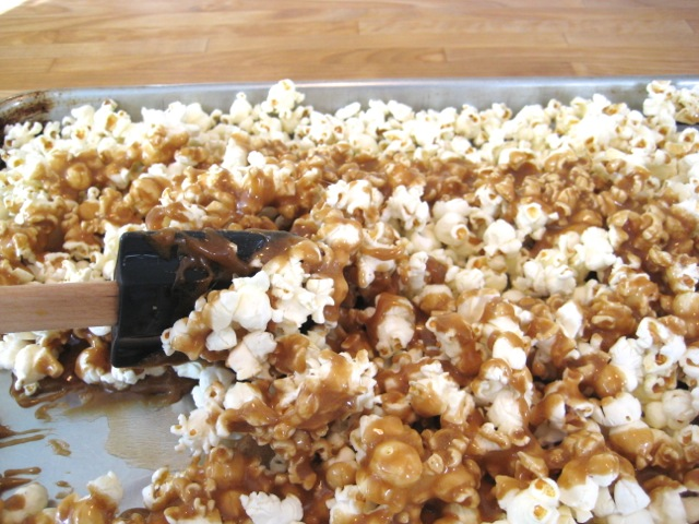 Coating the popped corn with the caramel mixture