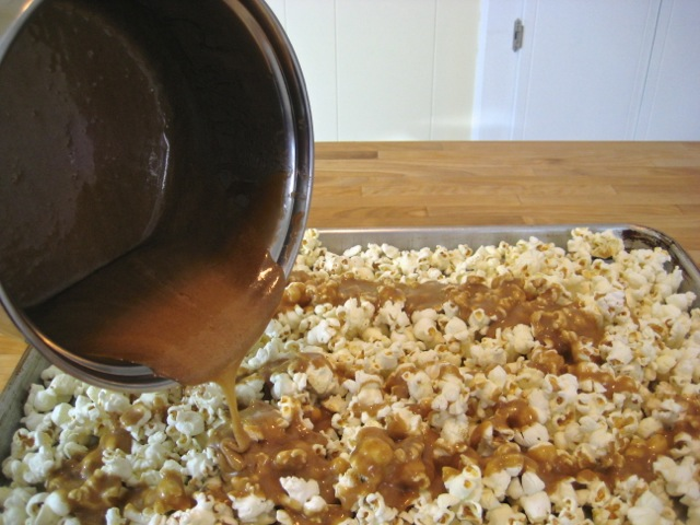 Pouring caramel mixture over popped corn