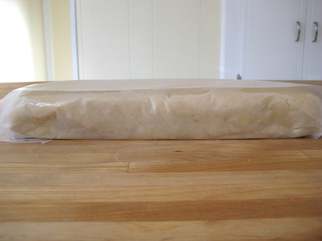 Dough wrapped in waxed paper, ready to refrigerate