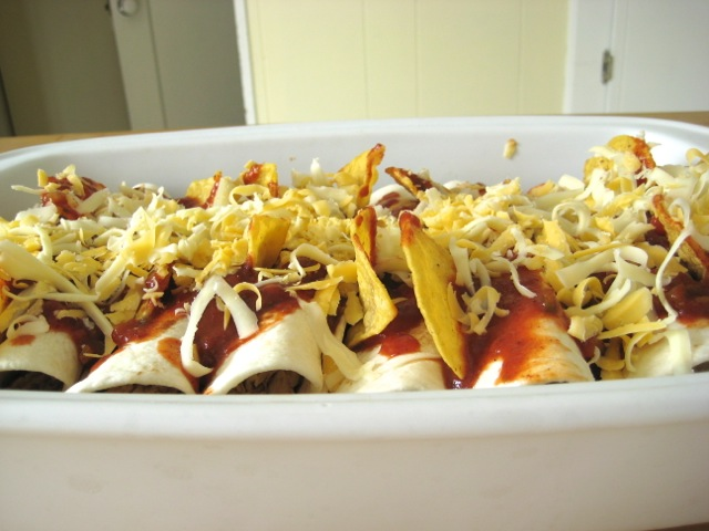 Cheese added to top of enchiladas