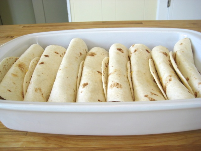 Enchiladas rolled and in baking dish
