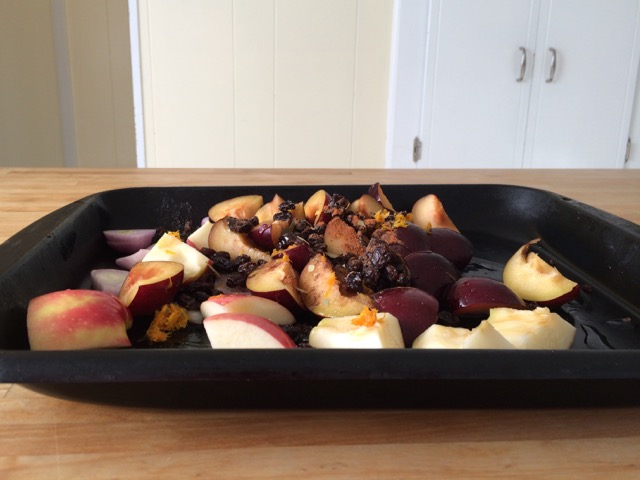 Plum mixture in bottom of roasting pan