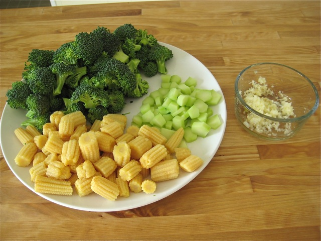 Broccoli florets and stems, baby corn, and garlic