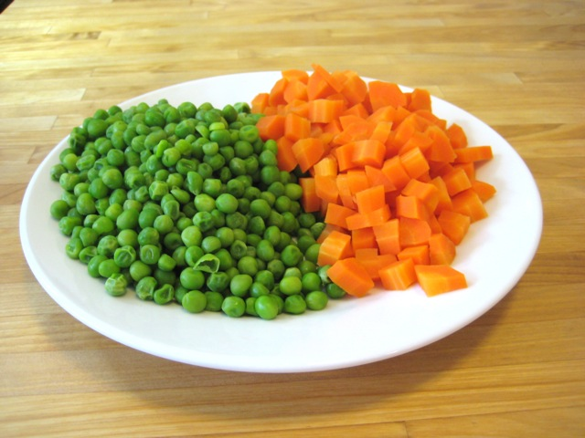 Cooked carrots and peas