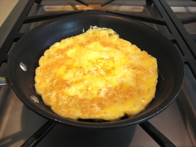 Eggs flipped in pan