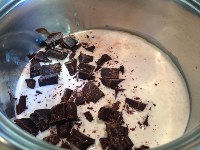 Whipping cream removed from heat, chocolate added