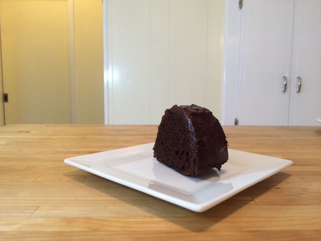 Slice of chocolate glazed bundt cake