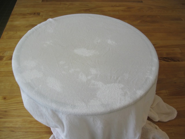 Dough covered with damp towel