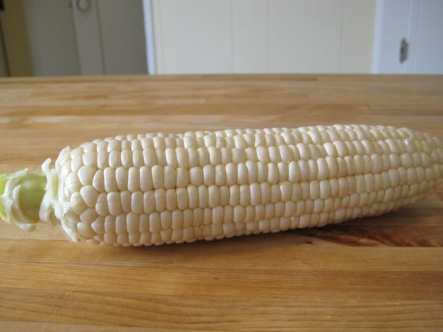 Ear of corn peeled and ready to cook