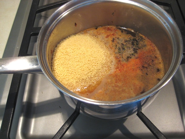 Saucepan removed from heat; couscous added to broth mixture