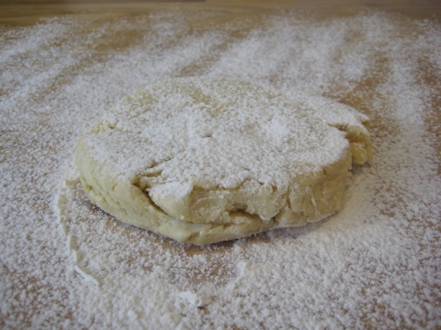 Dough flipped and sprinkled with flour