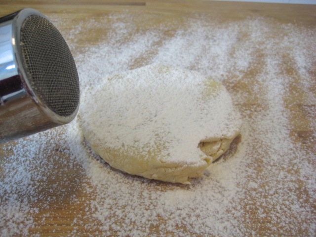 Dough sprinkled with flour, ready to flip