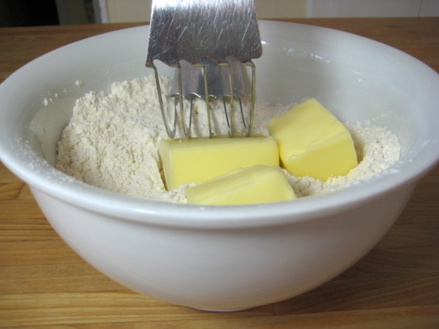 Cutting the butter into the flour