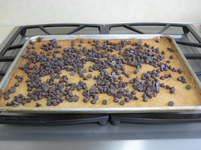 Chips added immediately as cookie crust comes out of the oven