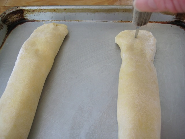 Beginning to score pastry with a knife