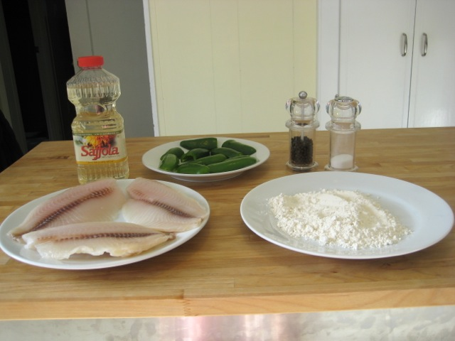 White fish with ingredients for frying