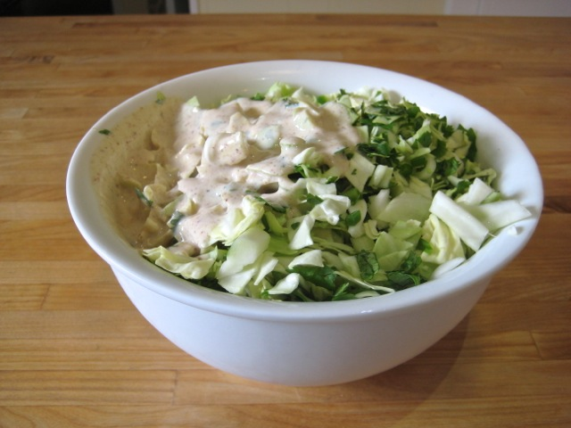 Sauce added to slaw mixture