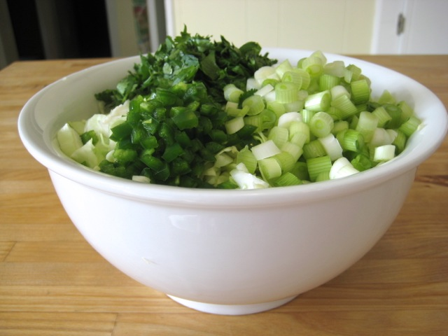 Cabbage, scallions, jalapeños, and cilantro in bowl