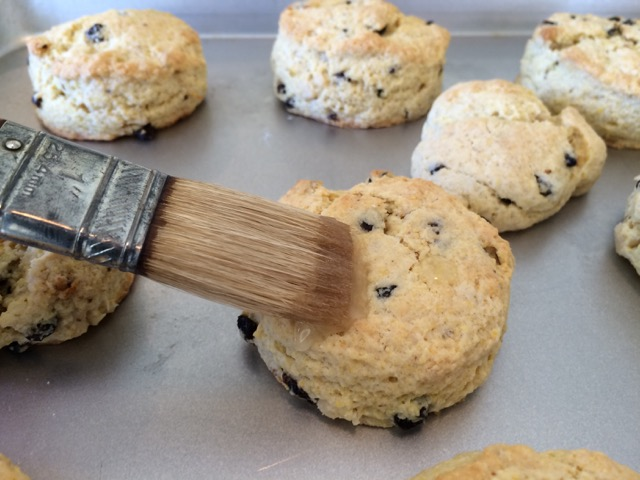 Brushing glaze onto a scone