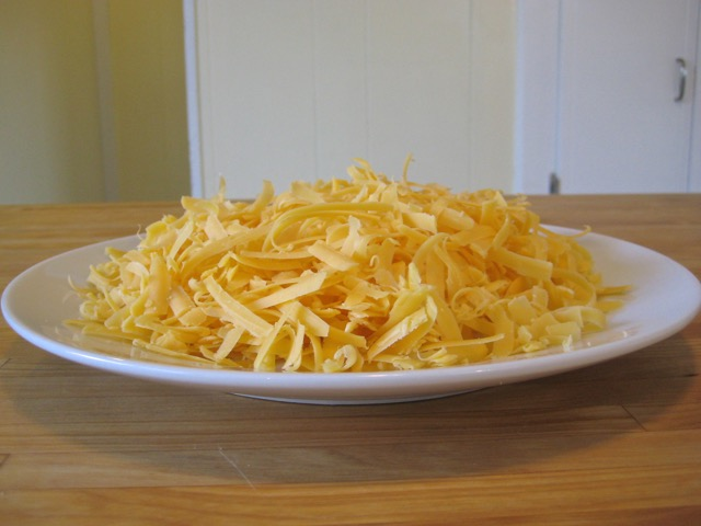 Grated sharp cheddar cheese for sauce