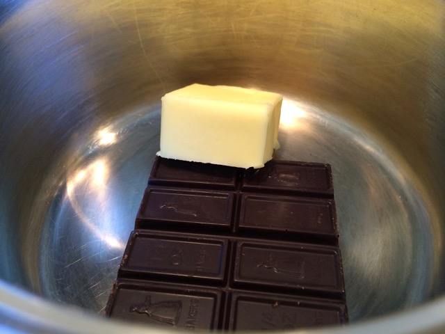 Chocolate and butter for glaze in saucepan