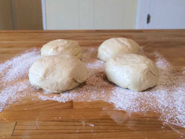 Dough shaped into 4 balls