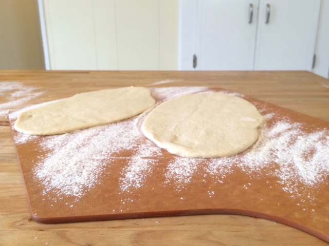 Dough placed on a floured pizza peel