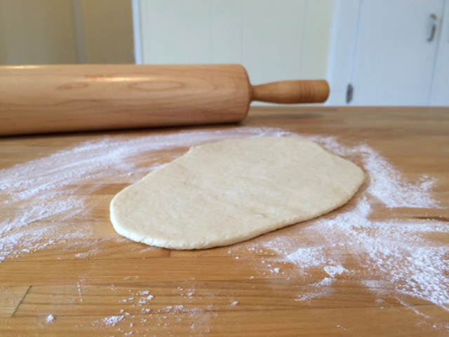 Dough rolled out into teardrop/oval shape