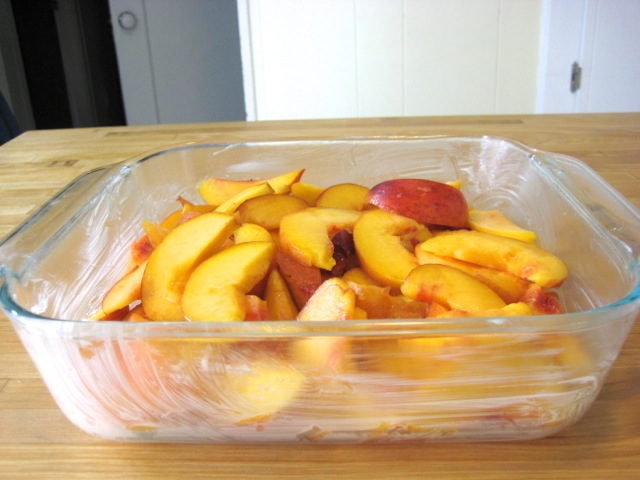Sliced peaches in baking pan