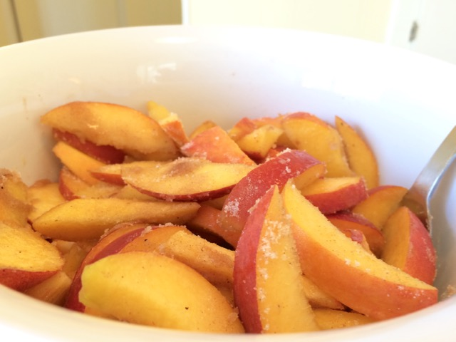 Cinnamon flour mixture mixed with peaches
