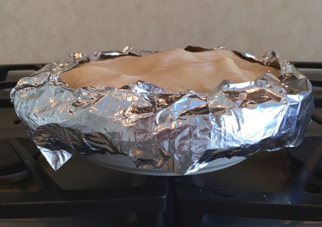 Top crust sealed and slit with foil added around edge