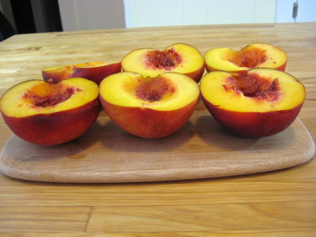 Peaches halved and pitted