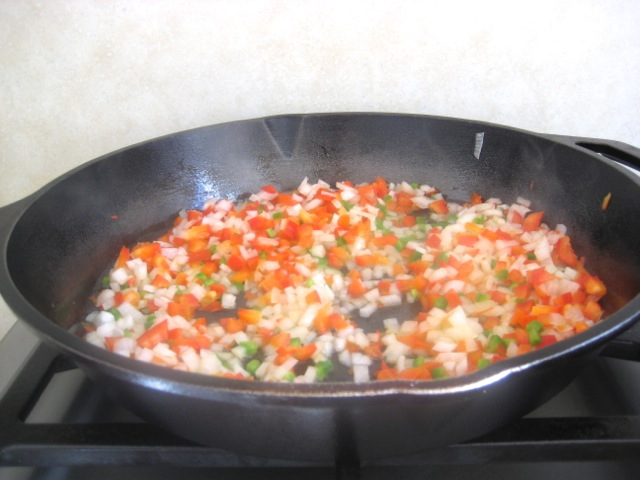 Chopped peppers and onion cooking