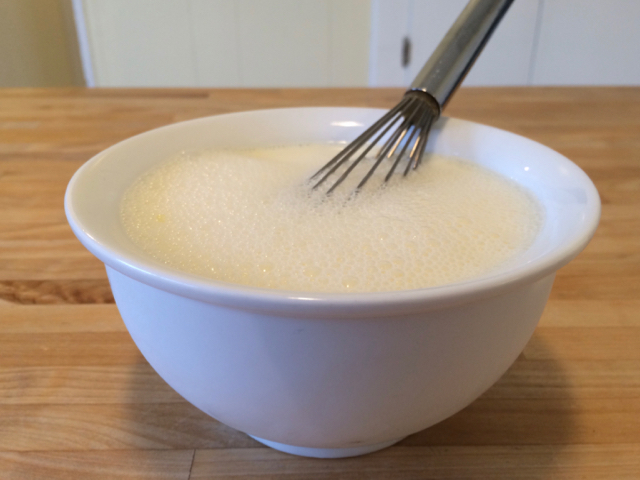Milk and egg whisked in a bowl