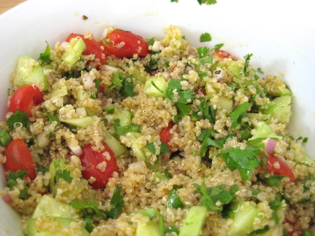 Dressing tossed into quinoa mixture