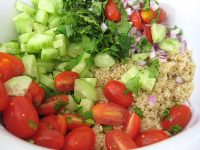 Quinoa and veggies in mixing bowl