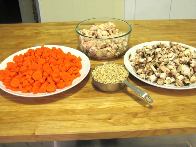 Chicken, mushrooms, carrots, and barley ready for Dutch oven