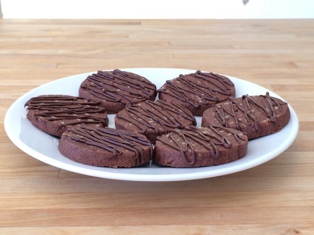 Melted chocolate drizzled over cookies, ready to serve