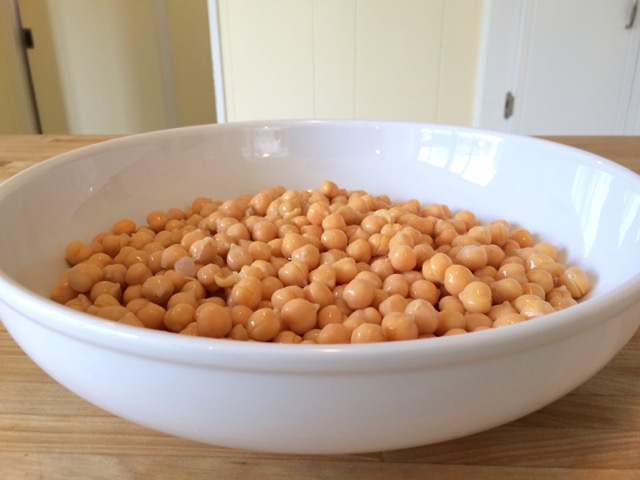 Drained and rinsed chickpeas in shallow bowl