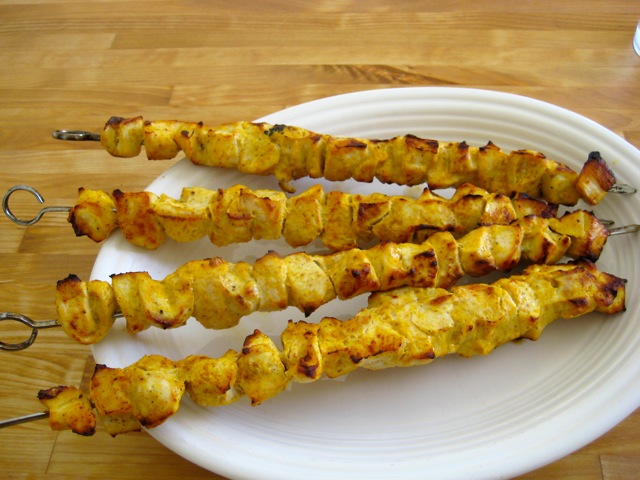 Tandoori chicken kebobs served