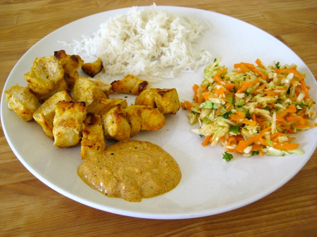 Tandoori chicken plate with rice and carrot cumin slaw